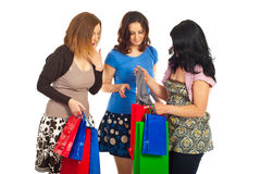 Friends women looking at purchased cloth. Friends women admiring what their friend purchased   and being happy isolate don white background Stock Images