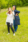 Friends women making selfie Stock Images
