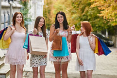 Friends Women with Shopping Bags Stock Photo