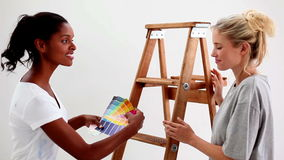 Friends wondering what colour choose for the wall stock footage