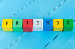 Friends - word on children's colourful cubes or Royalty Free Stock Photo