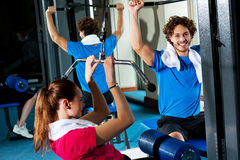 Friends working out together in a multi gym. Indoor gym shot Royalty Free Stock Photography