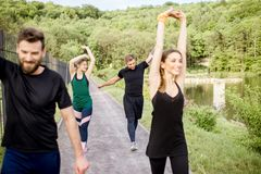 Friends during the workout outdoors Stock Photos