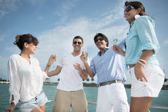 Friends on a yacht Royalty Free Stock Image
