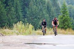 Friendshiop outdoor on mountain bike Stock Photo