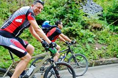 Friendshiop outdoor on mountain bike Royalty Free Stock Images