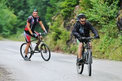 Friendshiop outdoor on mountain bike Stock Image