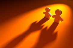 Friendship. 3d rendered figures on the orange background Stock Images