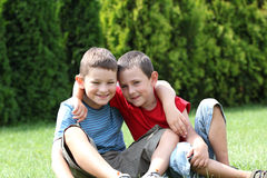 Friendship. Portrait of two boys, siblings, brothers and best friends smiling. Friends hugging Royalty Free Stock Image