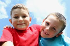 Friendship. Portrait of two boys, siblings, brothers and best friends giggling and making faces Royalty Free Stock Photo
