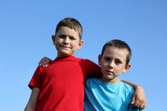 Friendship. Portrait of two boys, siblings, brothers and best friends smiling. Friends hugging Stock Photo