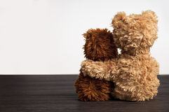 Friendship 2 teddy bears holding in one's arm stock photography