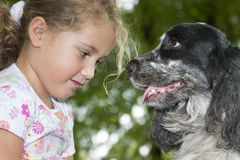 Friendship. Little girl playing with her dog Royalty Free Stock Photography