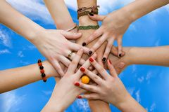 Friendship. The linked hands symbolizing teamwork and friendship