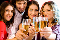 Friendship. Portrait of four people holding glasses of  champagne Royalty Free Stock Photography