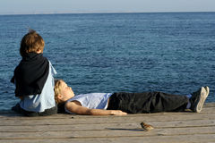 Friendship. Friends relaxing by sea, friendship Stock Images