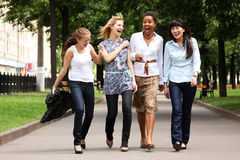 Friendship. Four young women walking in the park Royalty Free Stock Photo