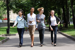 Friendship. Four young women walking in the park Royalty Free Stock Photography