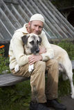 Friendship. Man with his white dog royalty free stock images