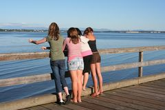 Friendship. Four girls looking out over the ocean Royalty Free Stock Photo