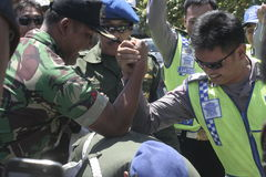 Friendship with arm wrestle between the police and the army in the stadium held their solo Central Java Stock Photo