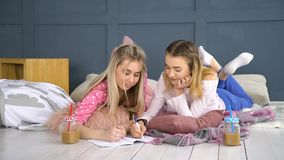 Pastime friends communication teenage mates. Friendship bff. fun leisure pastime. friends communication. young teenage mates at home drawing in the notebook Stock Photos