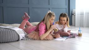 Friendship bff leisure pastime girlfriends home. Friendship bff. fun leisure pastime. girlfriends at home chatting, writing in the diary. young teenage mates stock footage