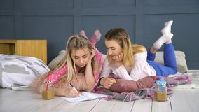 Friends communication writing notebook studying. Friendship bff. leisure pastime. friends communication writing in notebook. young teenage mates at home studying Stock Photography