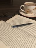 Friendship of books and coffee stock images