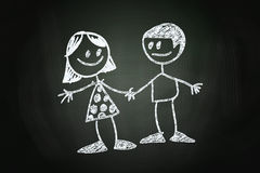Friendship. Between a Boy and a Girl Concept, drawn with Chalk on Blackboard Stock Photo