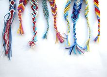 Free Friendship Bracelets Made Of Thread With Braids On White Background Royalty Free Stock Photos - 119033688