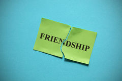 Friendship breakdown. (destroy a friendship). Torn of paper with the word Family. Concept Image. Close-up Royalty Free Stock Image