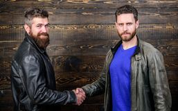 Friendship of brutal guys. Approved business deal. Handshake gesture meaning. Handshake symbol of successful deal. Have. Agreed. Strong handshake. Brutal royalty free stock images