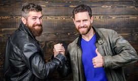 Friendship of brutal guys. Handshake symbol of successful deal. Approved business deal. Handshake gesture meaning. Have. Agreed. Brutal bearded men wear leather royalty free stock images