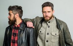 Friendship of brutal guys. Leadership concept. True friendship of mature friends. Male friendship. Brutal bearded men. Wear leather jackets. Real men royalty free stock photography