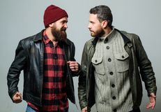 Friendship of brutal guys. Real friendship mature friends. Male friendship concept. Brutal bearded men wear leather. Jackets. Real men and brotherhood. Friends royalty free stock photos