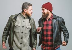Friendship of brutal guys. Real friendship mature friends. Male friendship concept. Brutal bearded men wear leather. Jackets. Real men and brotherhood. Friends stock photo