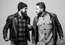 Friendship of brutal guys. Real friendship mature friends. Male friendship concept. Brutal bearded men wear leather. Jackets. Real men and brotherhood. Friends royalty free stock image