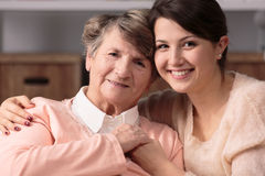 Friendship between carer and senior. Image of friendship between happy carer and senior woman Royalty Free Stock Image