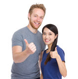 Friendship of caucasian and asian with thumb up Royalty Free Stock Images