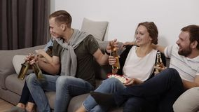 Friendship, communication, party time -group of four are hanging out together - male and female company sitting on a stock video footage