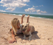 Friendship concept girl with her dog lying Stock Images