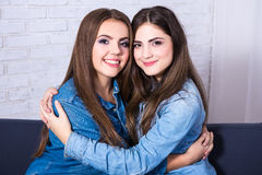 Friendship concept - portrait of two hugging girls Royalty Free Stock Photos