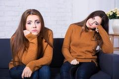 Friendship, conflict or boredom concept - sad girls after quarre. Friendship, conflict or boredom concept - two sad girls after quarrel Stock Photos