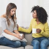 Women support her girlfriend, talking about problems at home. Friendship consoling and care. Women support her girlfriend, talking about problems at home royalty free stock photography