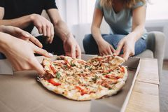 Leisure,party, food delivery, friends eating pizza royalty free stock image