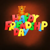 Friendship day lettering title with teddy bear Stock Photos