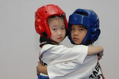 Friendship first, competition later-Taekwondo training hall. In the Taekwondo training hall, the children are participating in various Taekwondo training Stock Photography