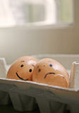 Friendship forever. A happy egg and a sad egg Stock Photo