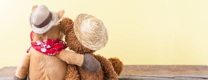 Friendship, teddy bear holding plush horse in its arms, banner Royalty Free Stock Photo